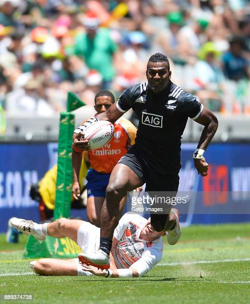 Joe Ravouvou of New Zealand and Harry Glover of England in action during day 2 of the 2017 HSBC Cape Town Sevens match between England and New...