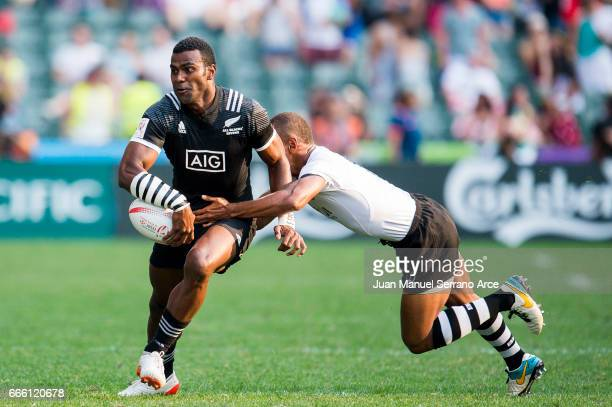 Joe Ravouvou of New Zealand is tackled during the 2017 Hong Kong Sevens match between Fiji and New Zealand at Hong Kong Stadium on April 8 2017 in...