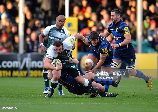 Joe Rees and Donncha O'Callaghan of Worcester Warriors tackle Greg Bateman of Leicester Tigers during the Aviva Premiership match between Worcester...
