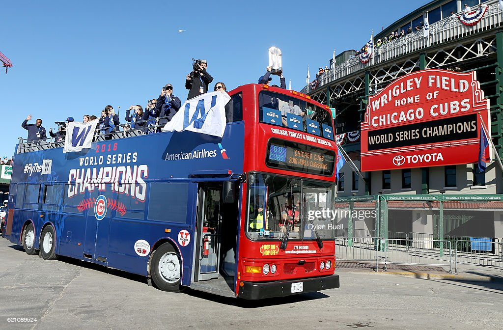 Joe Ricketts hoists the World Series trophy atop a bus driving past Wrigley Field during the 2016 World Series victory parade for the Chicago Cubs on November 4, 2016 in Chicago, Illinois. The Cubs won their first World Series championship in 108 years after defeating the Cleveland Indians 8-7 in Game 7.