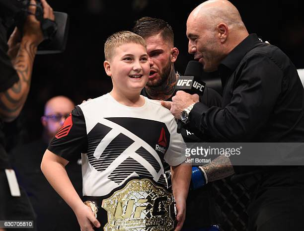 Joe Rogan interviews a young fan after Cody Garbrandt's victory over Dominick Cruz in their UFC bantamweight championship bout during the UFC 207...