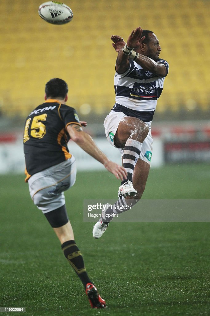 Joe Rokocoko of Auckland attempts to charge down the kick of Apoua Stewart of Wellington during round three of the ITM Cup match between Wellington...