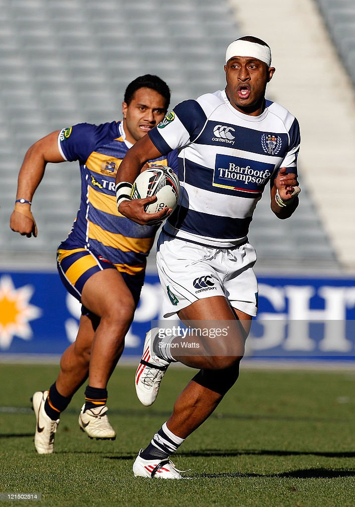 Joe Rokocoko of Auckland makes a break as Lelia Masaga of Bay of Plenty gives chase during the round 11 ITM Cup match between Auckland and Bay of...