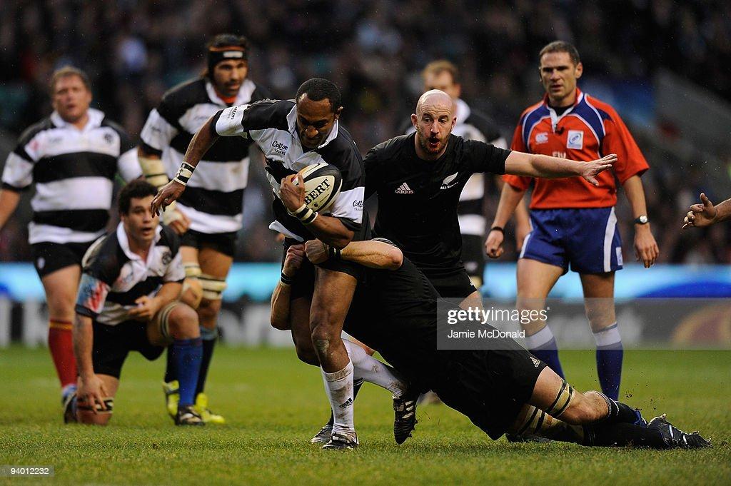 Joe Rokocoko of Barbarians runs into the New Zealand backs during the MasterCard Trophy match between Barbarians and New Zealand at Twickenham...