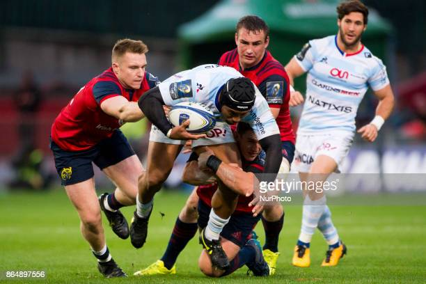 Joe Rokocoko of Racing 92 tackled by Ian Keatley and Rory Scannell of Munster during the European Rugby Champions Cup Round 2 match between Munster...