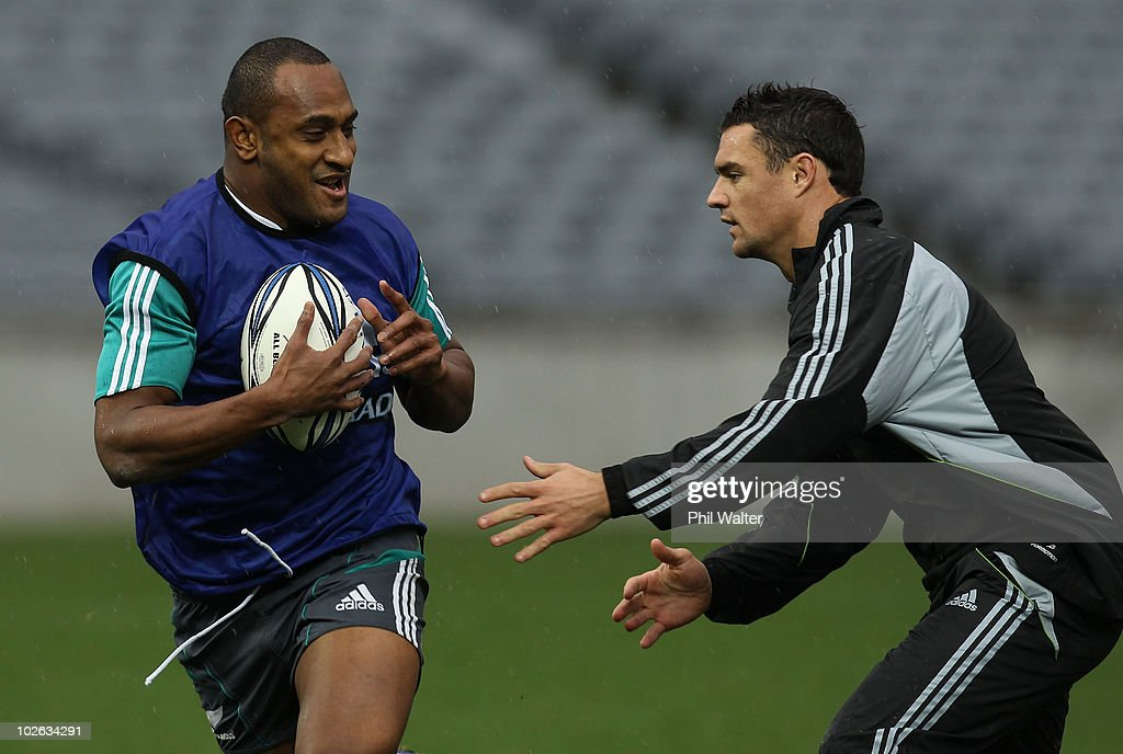 Joe Rokocoko of the All Blacks avoids a tackle from Dan Carter during a New Zealand All Blacks training session at Eden Park on July 6 2010 in...