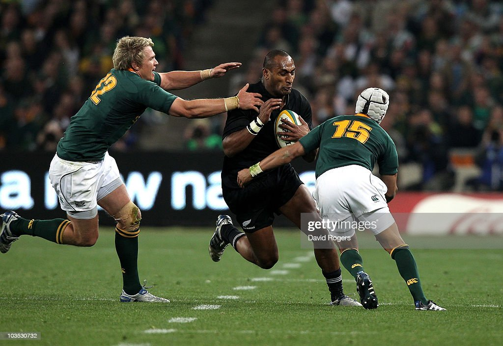 Joe Rokocoko of the All Blacks is tackled by Jean de Villiers and Gio Apion during the 2010 TriNations match between the South African Springboks and...