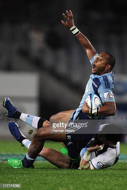 Joe Rokocoko of the Blues is brought down during the Super Rugby qualifier match between the Blues and the Waratahs at Eden Park on June 24 2011 in...