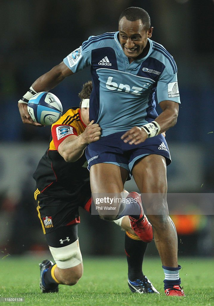 Joe Rokocoko of the Blues is tackled by Culum Retallick of the Chiefs during the round 16 Super Rugby match between the Blues and the Chiefs at Eden...