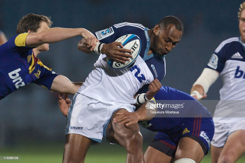 <a gi-track='captionPersonalityLinkClicked' href=/galleries/search?phrase=Joe+Rokocoko&family=editorial&specificpeople=161380 ng-click='$event.stopPropagation()'>Joe Rokocoko</a> of the Blues is tackled during the round 11 Super Rugby match between the Highlanders and the Blues at Carisbrook Stadium on April 29, 2011 in Dunedin, New Zealand.