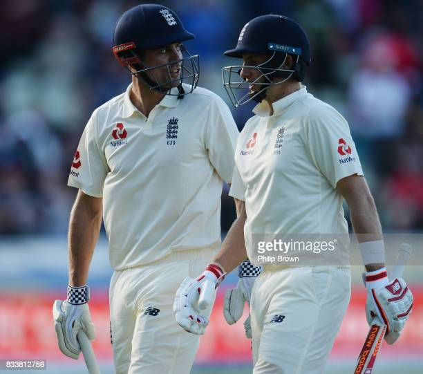 Joe Root and Alastair Cook of England leave the field for the tea break during the first day of the 1st Investec Test match between England and the...