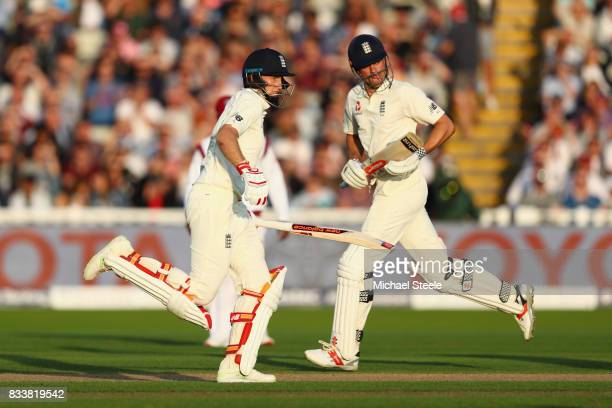 Joe Root and Alastair Cook of England pile on the runs during day one of the 1st Investec Test match between England and West Indies at Edgbaston on...