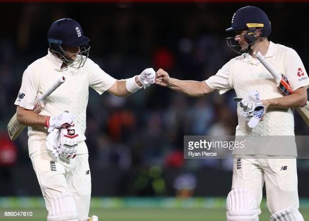 Joe Root and Chris Woakes of England leave the ground at stumps during day four of the Second Test match during the 2017/18 Ashes Series between...