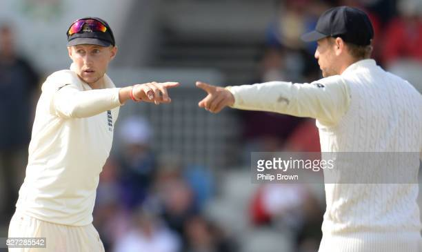 Joe Root and Dawid Malan of England point during the fourth day of the 4th Investec Test match between England and South Africa at Old Trafford...