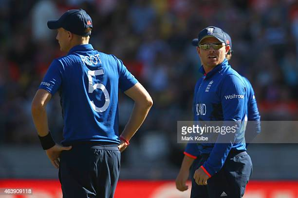Joe Root and Ian Bell of England look dejected as they feild during the 2015 ICC Cricket World Cup match between England and New Zealand at...