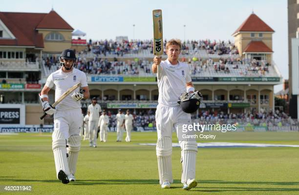 Joe Root and James Anderson of England leave the field at stumps on day three of 1st Investec Test match between England and India at Trent Bridge on...