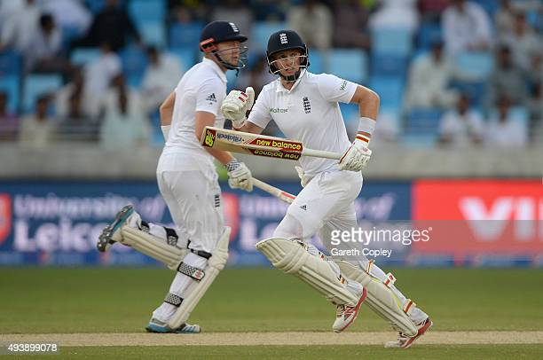 Joe Root and Jonathan Bairstow of England score runs during day two of the 2nd test match between Pakistan and England at Dubai Cricket Stadium on...