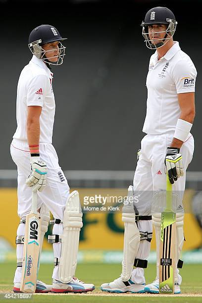 Joe Root and Kevin Pietersen of England speak between overs during day four of the Second Ashes Test Match between Australia and England at Adelaide...