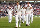 Joe Root and Stuart Broad of England walk from the ground after day four of the 1st Investec Ashes Test match between England and Australia at SWALEC...