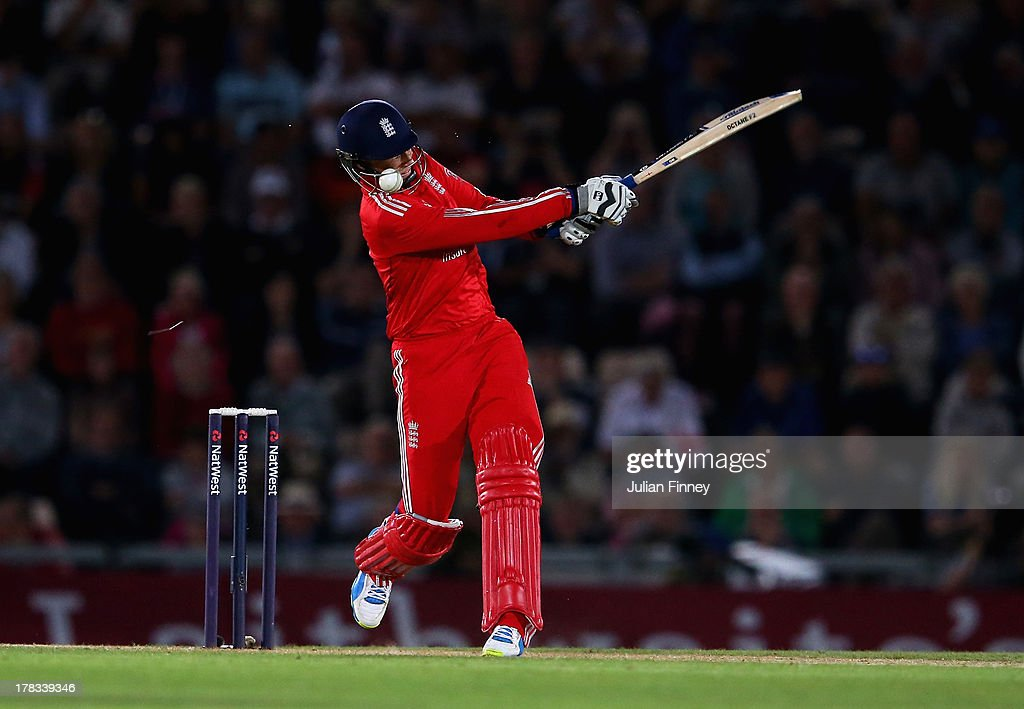 <a gi-track='captionPersonalityLinkClicked' href=/galleries/search?phrase=Joe+Root&family=editorial&specificpeople=6688996 ng-click='$event.stopPropagation()'>Joe Root</a> of England bats as the ball gets caught in his helmut during the 1st NatWest Series T20 match between England and Australia at Ageas Bowl on August 29, 2013 in Southampton, England.