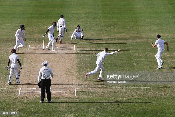 Joe Root of England begins his celebrations after claiming the wicket of Darren Bravo of West Indies caught by Chris Jordan at first slip during day...