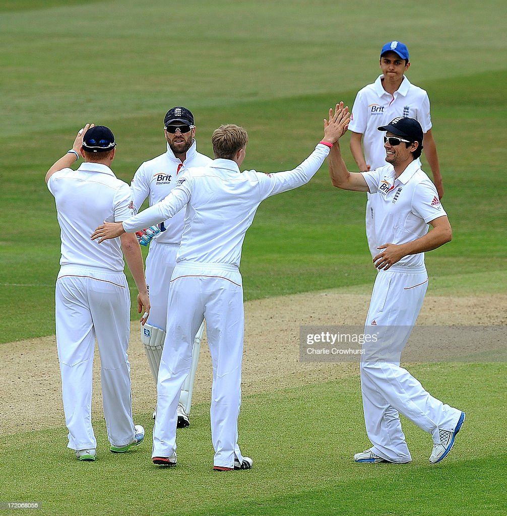 <a gi-track='captionPersonalityLinkClicked' href=/galleries/search?phrase=Joe+Root&family=editorial&specificpeople=6688996 ng-click='$event.stopPropagation()'>Joe Root</a> of England celebrates a wicket with <a gi-track='captionPersonalityLinkClicked' href=/galleries/search?phrase=Alastair+Cook+-+Cricket+Player&family=editorial&specificpeople=571475 ng-click='$event.stopPropagation()'>Alastair Cook</a> during the LV=Challenge Day 2 match between Essex and England at Ford County Ground on July 01, 2013 in Chelmsford, England.