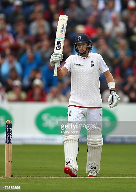 Joe Root of England celebrates after reaching his half century during day one of the 1st Investec Ashes Test match between England and Australia at...