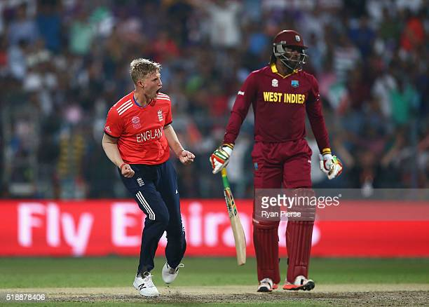 Joe Root of England celebrates after taking the wicket of Chris Gayle of the West Indies during the ICC World Twenty20 India 2016 Final match between...