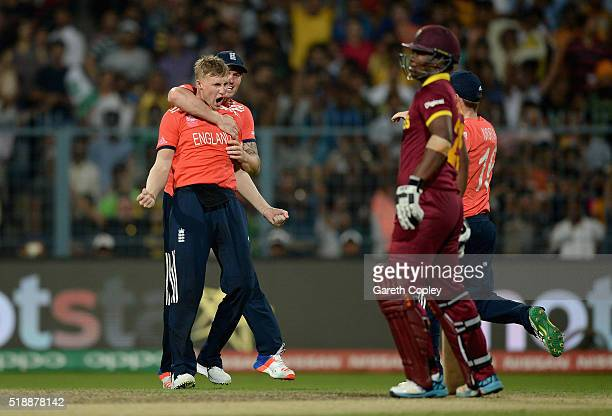 Joe Root of England celebrates dismissing Johnson Charles of the West Indies during the ICC World Twenty20 India 2016 Final between England and the...