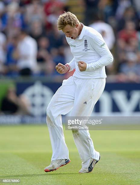 Joe Root of England celebrates dismissing Mitchell Johnson of Australia during day four of the 1st Investec Ashes Test match between England and...