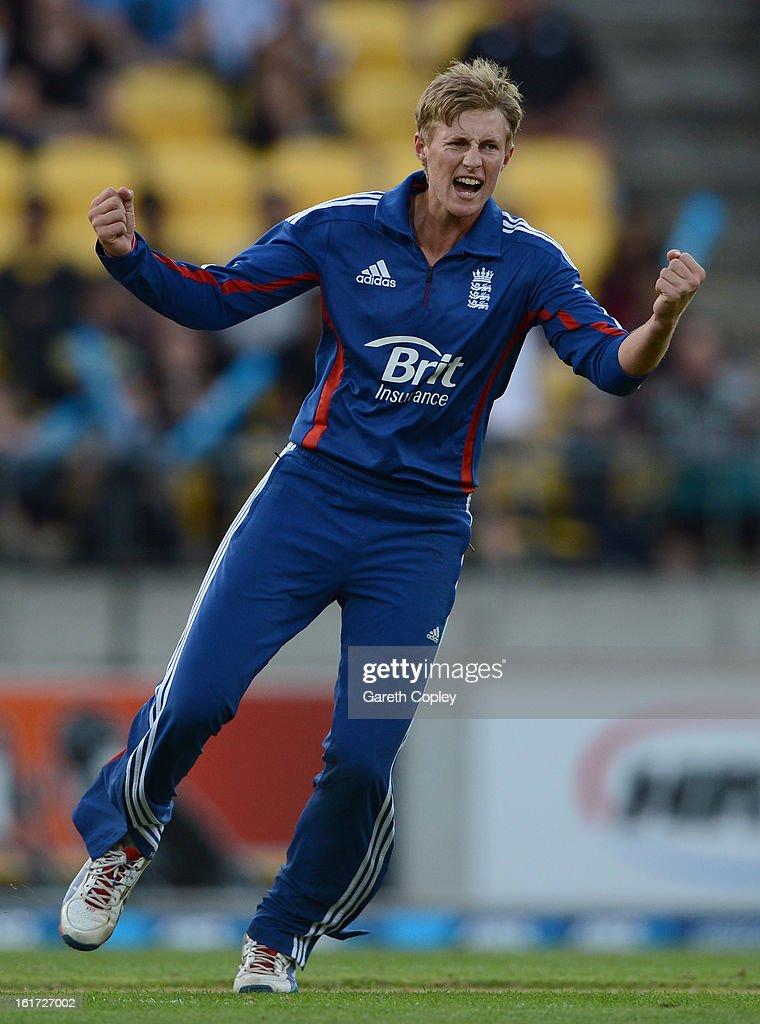 Joe Root of England celebrates dismissing Ross Taylor of New Zealandduring the third Twenty20 International match between New Zealand and England at Westpac Stadium on February 15, 2013 in Wellington, New Zealand.