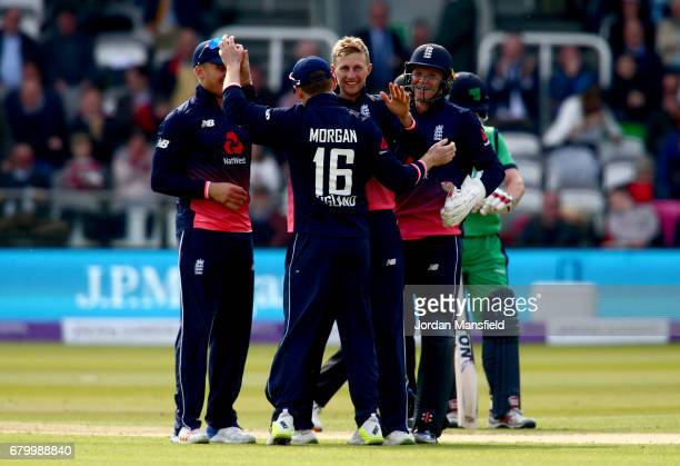 Joe Root of England celebrates with his teammates after dismissing Ed Joyce of Ireland during the Royal London ODI match between England and Ireland...