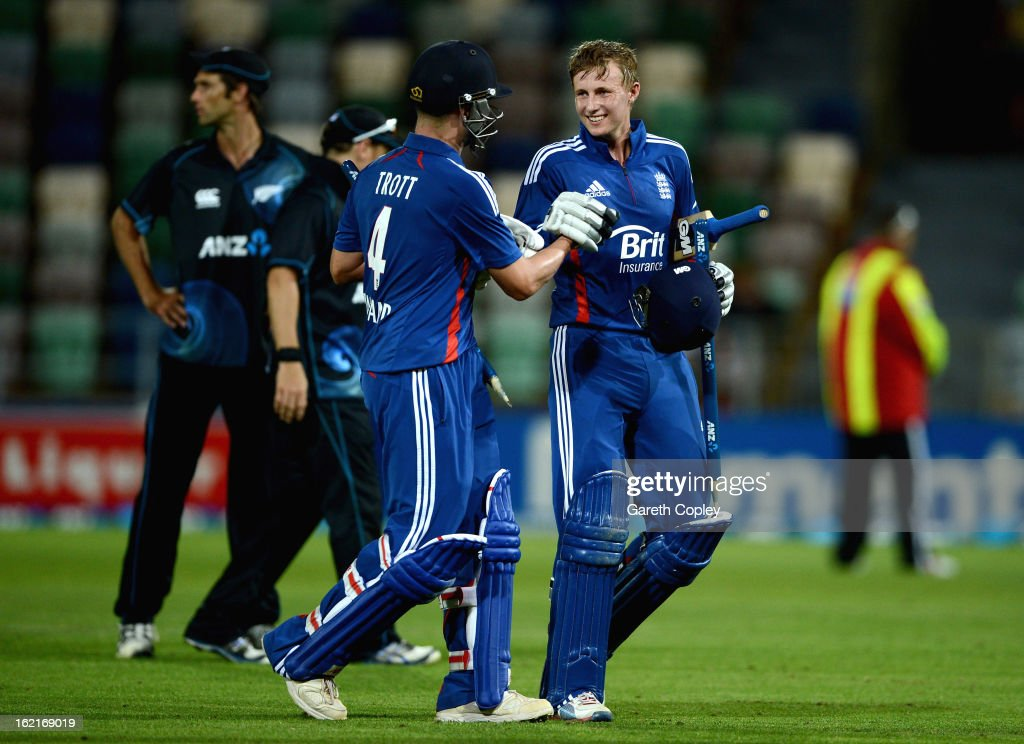 Joe Root of England celebrates with Jonathan Trott after winning the second match of the international Twenty20 series between New Zealand and England at McLean Park on February 20, 2013 in Napier, New Zealand.
