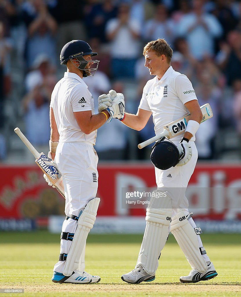 <a gi-track='captionPersonalityLinkClicked' href=/galleries/search?phrase=Joe+Root&family=editorial&specificpeople=6688996 ng-click='$event.stopPropagation()'>Joe Root</a> of England (R) celebrates with teammate <a gi-track='captionPersonalityLinkClicked' href=/galleries/search?phrase=Matt+Prior+-+Cricket+Player&family=editorial&specificpeople=13652111 ng-click='$event.stopPropagation()'>Matt Prior</a> after reaching his century during day one of the 1st Investec Test match between England and Sri Lanka at Lord's Cricket Ground on June 12, 2014 in London, England.