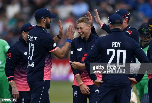 Joe Root of England celebrates with teammates after dismissing Ireland captain William Porterfield during the Royal London One Day International...