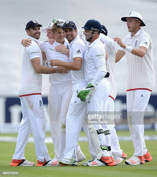 Joe Root of England celebrates with teammates after dismissing Mitchell Starc of Australia during day four of the 1st Investec Ashes Test match...