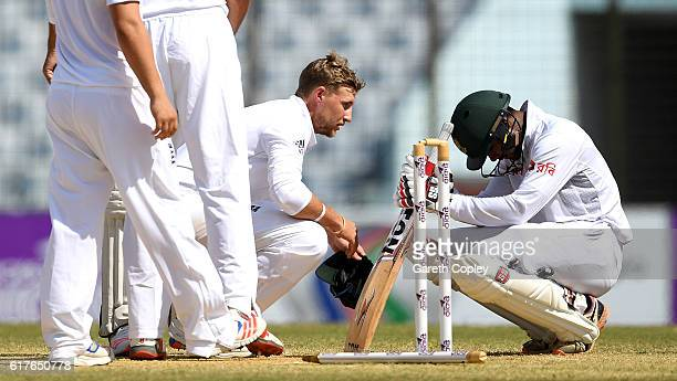 Joe Root of England consoles not out Bangladeshie batsman Sabbir Rahman after winning the first Test between Bangladesh and England at Zohur Ahmed...