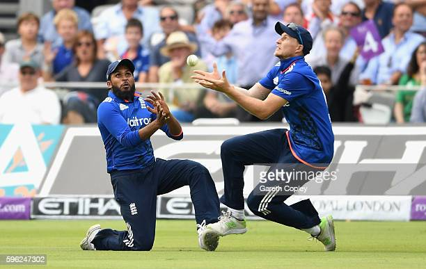 Joe Root of England crashes into teammate Adil Rashid as he catches out Hasan Ali of Pakistan during the 2nd One Day International match between...