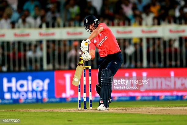 Joe Root of England drives through the offside during the 3rd International T20 match between Pakistan and England at Sharjah Cricket Stadium on...