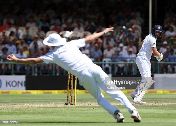 Joe Root of England dropped by Chris Morris of the Proteas during day 1 of the 2nd Test match between South Africa and England at PPC Newlands on...