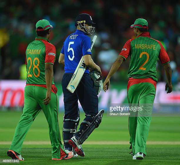 Joe Root of England exchanges words with Masrafe Bin Mortaza of Bangladesh during the 2015 ICC Cricket World Cup match between England and Bangladesh...