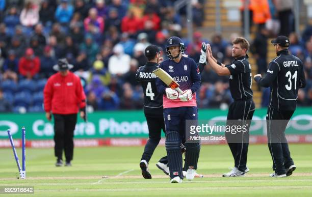 Joe Root of England heads to the pavillion after playing on off the bowling of Corey Anderson for 64 runs during the ICC Champions Trophy match...