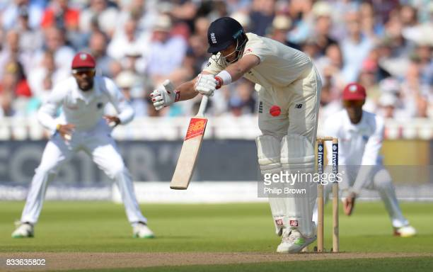 Joe Root of England hit by a delivery during the first day of the 1st Investec Test match between England and the West Indies at Edgbaston cricket...