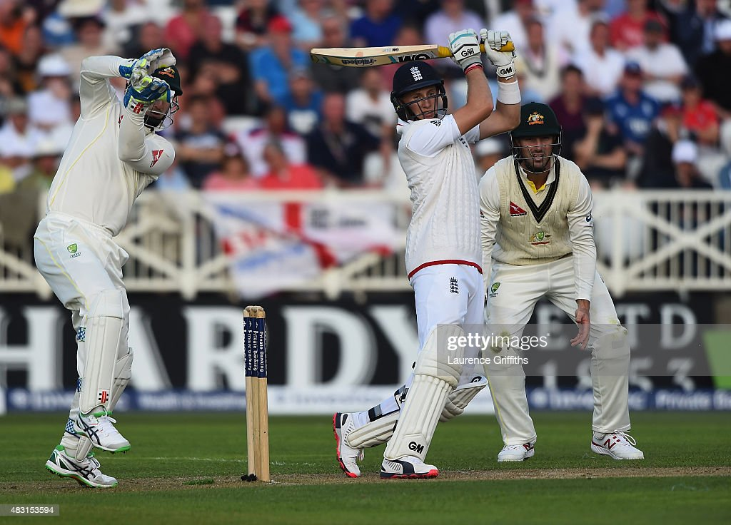 Joe Root of England hits out to the boundary as Peter Nevill of Australia looks on during day one of the 4th Investec Ashes Test match between England and Australia at Trent Bridge on August 6, 2015 in Nottingham, United Kingdom.