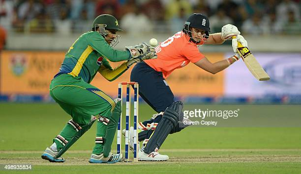 Joe Root of England hits past Sarfraz Ahmed of Pakistan during the 2nd International T20 between Pakistan and England at Dubai Cricket Stadium on...
