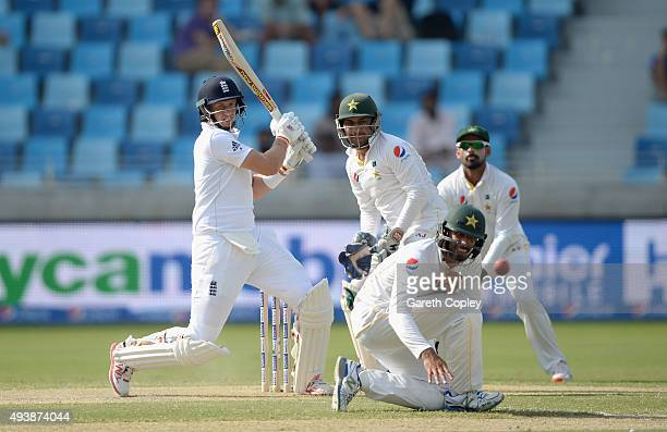 Joe Root of England hits past Shan Masood of Pakistan during day two of the 2nd test match between Pakistan and England at Dubai Cricket Stadium on...