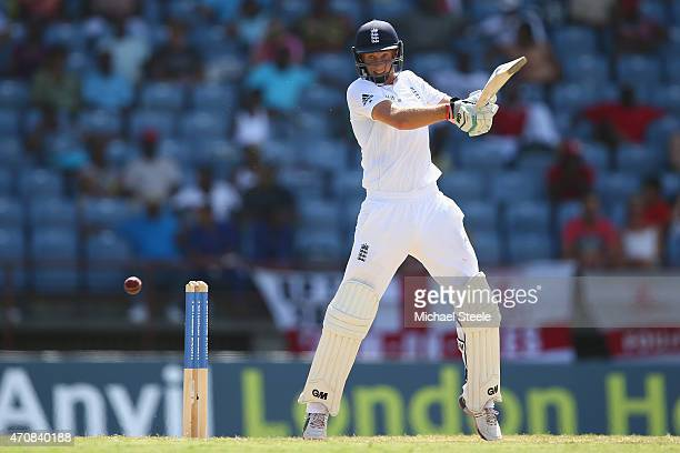 Joe Root of England hits to the offside during day three of the 2nd Test match between West Indies and England at the National Cricket Stadium in St...