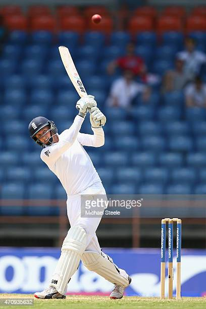 Joe Root of England hits to the onside boundary during day four of the 2nd Test match between West Indies and England at the National Cricket Stadium...