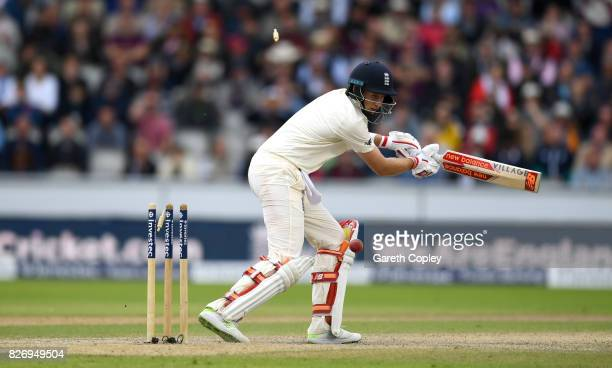 Joe Root of England is bowled by Duanne Olivier of South Africa during day three of the 4th Investec Test match between England and South Africa at...