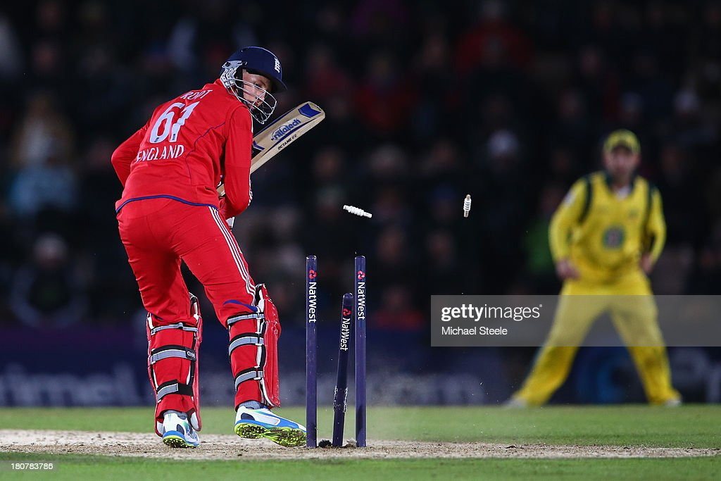 <a gi-track='captionPersonalityLinkClicked' href=/galleries/search?phrase=Joe+Root&family=editorial&specificpeople=6688996 ng-click='$event.stopPropagation()'>Joe Root</a> of England is bowled by Mitchell Johnson of Australia during the 5th NatWest Series ODI between England and Australia at the Ageas Bowl on September 16, 2013 in Southampton, England.